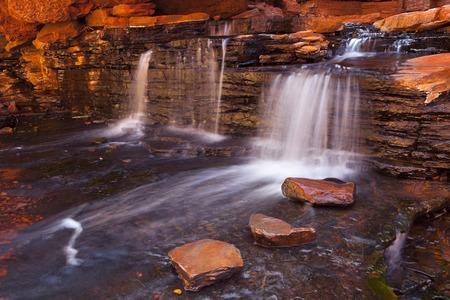 western australia: A small waterfall in the Hancock Gorge in Karijini National Park, Western Australia. Stock Photo