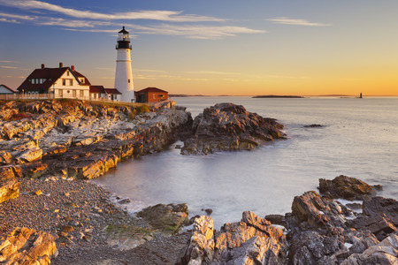 water's: The Portland Head Lighthouse in Cape Elizabeth, Maine, USA. Photographed at sunrise. Stock Photo