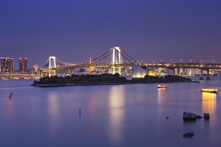 Tokyo Rainbow Bridge over the Tokyo Bay in Tokyo, Japan. Photographed at night.