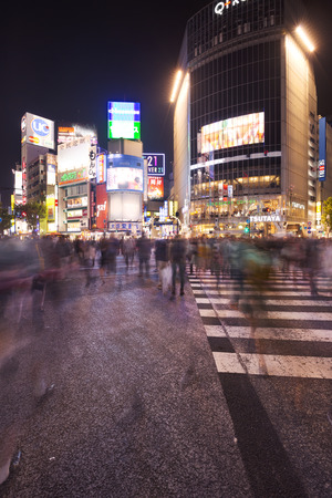 blurred people: The busy Shibuya Crossing in Tokyo at night. Editorial