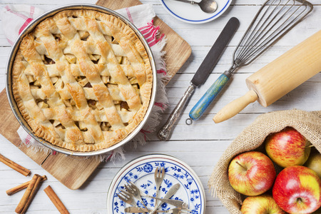 Homemade Dutch apple pie and ingredients on a rustic table. Photographed from directly above. Stock Photo