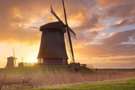 schermerhorn: Traditional Dutch windmills at sunrise near Schermerhorn in The Netherlands. Stock Photo
