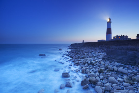 The Portland Bill Lighthouse on the Isle of Portland in Dorset, England at night.