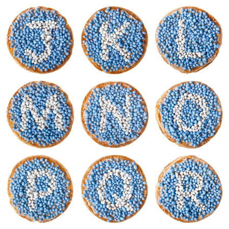 r p m: Beschuit met muisjes, a traditional treat to celebrate the birth of a child in The Netherlands. Blue for a boy. High resolution alphabet J to R. Isolated on white.