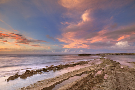 water's edge: A tropical rocky coast at sunset. Photographed at Playa Canoa on Curaao, The Netherlands Antilles. Stock Photo
