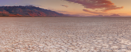 Cracked earth in the Alvord Playa, a dry lakebed in the Alvord Desert in southeastern Oregon, USA. Photographed at sunrise. Stock Photo