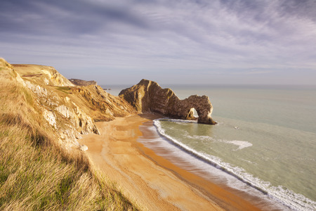 rock arch: The Durdle Door rock arch on the Dorset Coast in Southern England, photographed from above.