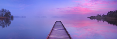no photo: A small jetty on a still lake on a quiet morning at dawn, near Amsterdam in The Netherlands. Stock Photo