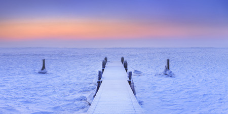 jetty: Jetty on a frozen lake. Photographed at sunrise on a record-breaking cold morning in The Netherlands.