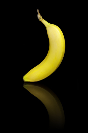 reflective: A banana on a black reflective background.