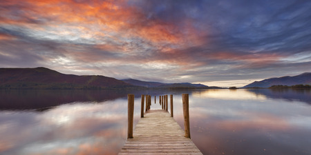 water's: A flooded jetty in Derwent Water, Lake District, England. Photographed at sunset. Stock Photo