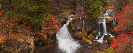 The Ryuzu Falls Ryuzu-no-taki near Nikko, Japan surrounded by autumn colors.
