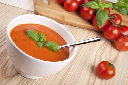 soup bowl: Tomato soup with basil in a bowl. Stock Photo