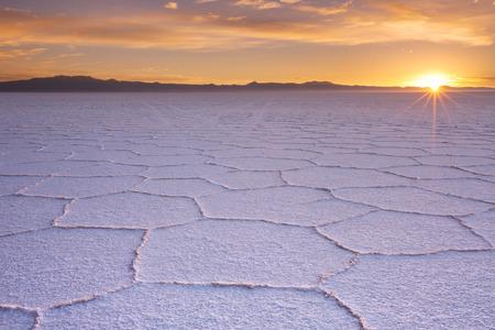 The worlds largest salt flat, Salar de Uyuni in Bolivia, photographed at sunrise.