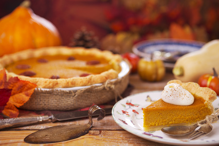 Homemade pumpkin pie on a rustic table with autumn decorations. Reklamní fotografie - 44246271