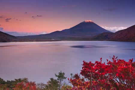 stratovolcano: Last light on the peak of the iconic Mount Fuji Fujisan in Japan. Photographed from Lake Motosu Motosuko at sunset.