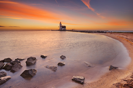 The lighthouse on the island of Marken in The Netherlands. Photographed at sunrise.