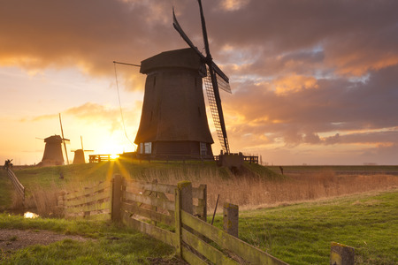schermerhorn: Traditional Dutch windmills at sunrise near Schermerhorn in The Netherlands. Stock Photo