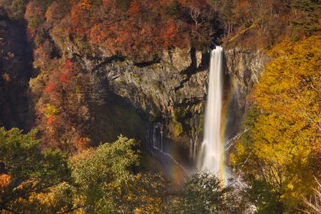 The Kegon Falls Kegon-no-taki near Nikko, Japan surrounded by autumn colors.