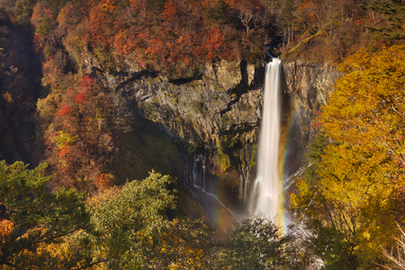 japanese fall foliage: The Kegon Falls Kegon-no-taki near Nikko, Japan surrounded by autumn colors.