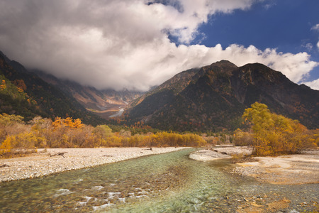 japanese fall foliage: Autumn colors along the Azusa River in Kamikochi National Park in Japan.