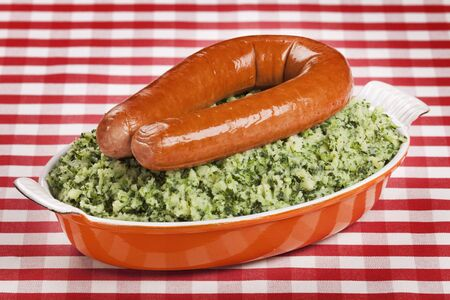 smoked sausage: A dish with Boerenkool met worst or kale with smoked sausage; a traditional Dutch meal. Stock Photo