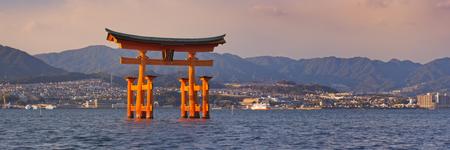 The famous torii gate of the Itsukushima Shrine on Miyajima . Photographed at sunset.