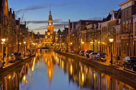 A canal and the tower of the Waag in the city of Alkmaar, The Netherlands.