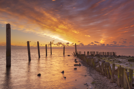 Spectacular sunrise colours over sea on the island of Texel in The Netherlands.