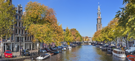 westerkerk: A canal with the Westerkerk tower in the city of Amsterdam, The Netherlands. Photographed on a beautiful day in early autumn.
