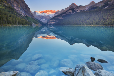 louise: Beautiful Lake Louise in Banff National Park, Canada. Photographed at sunrise.