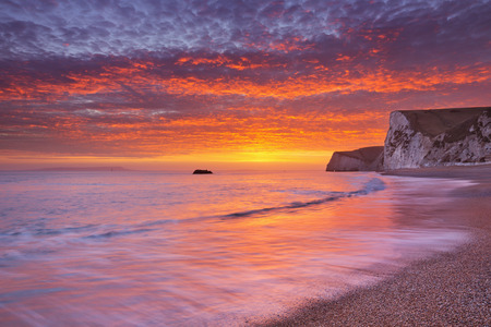 durdle: Cliffs at the beach of Durdle Door on the Dorset Coast of Southern England at sunset. Stock Photo