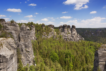 free image: Rock formations at the Bastei in the Saxon Switzerland region in Germany. Photographed on a bright and sunny day.