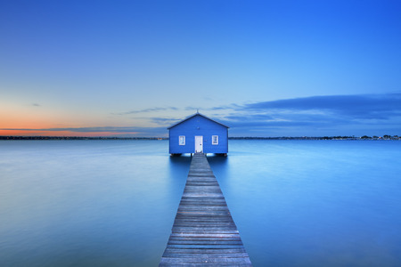jetty: Sunrise over the Matilda Bay boathouse in the Swan River in Perth, Western Australia.