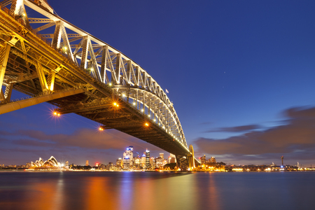 sydney opera house: The Harbour Bridge, Sydney Opera House and Central Business District of Sydney. Photographed at night. Stock Photo