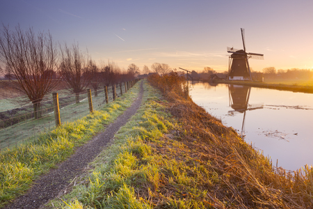 dutch windmill: A traditional Dutch windmill near Abcoude in The Netherlands. Photographed at sunrise. Stock Photo
