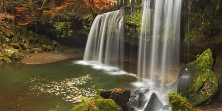 autumn colors: The Nabegataki Falls on the island of Kyushu, Japan surrounded by autumn colors.