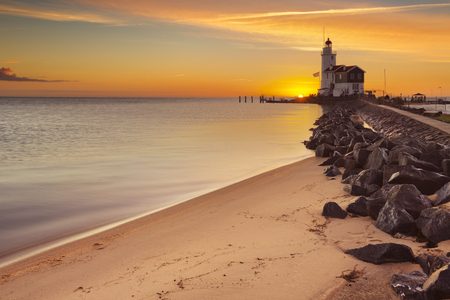 marken: The lighthouse on the island of Marken in The Netherlands. Photographed at sunrise.