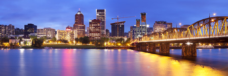 portland: The skyline of Portland, Oregon at night. Photographed from across the Willamette River.