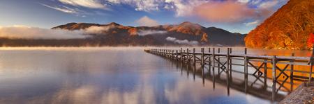 on lake: Lake Chuzenji Chuzenjiko near Nikko in Japan. Photographed on a beautiful still morning in autumn at sunrise.