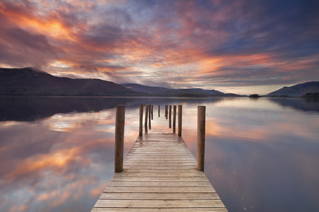 A flooded jetty in Derwent Water, Lake District, England. Photographed at sunset. Stok Fotoğraf