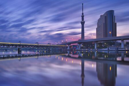 asakusa: The Tokyo Sky Tree in Tokyo, Japan, reflected in the Sumida River at sunrise.