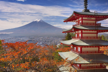 japanese fall foliage: The Chureito pagoda and Mount Fujisan Fuji in the background on a bright day in autumn.