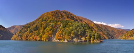 japanese fall foliage: Bright autumn colours along the Azusa Lake in the Northern Japanese Alps.