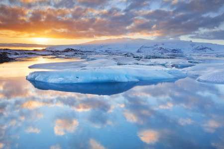 arctic waters: Icebergs in the Jokulsarlon glacier lake in Iceland in winter. Photographed at sunset. Stock Photo