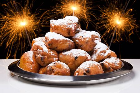 dutch culture: Oliebollen, traditional Dutch pastry for New Years Eve. Stock Photo