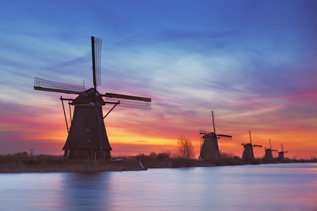 colourful sky: Traditional Dutch windmills with a colourful sky just before sunrise. Photographed at the famous Kinderdijk.