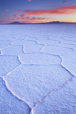 The worlds largest salt flat, Salar de Uyuni in Bolivia, photographed at sunrise.