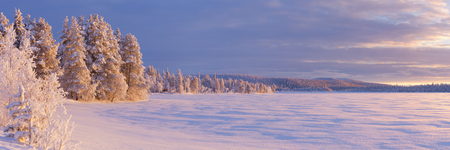 arctic waters: A beautiful lake in Finnish Lapland in winter. Photographed at ijjrvi at sunset.