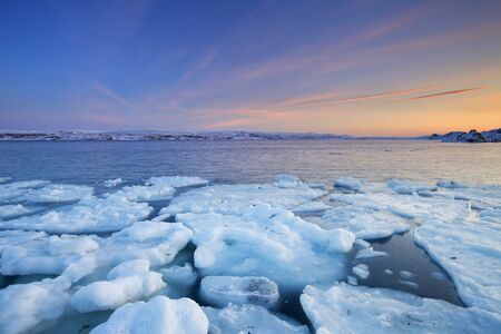 arctic waters: Ice floes on the Arctic Ocean in Norway, photographed at the Porsangerfjord in Norway at sunset. Stock Photo